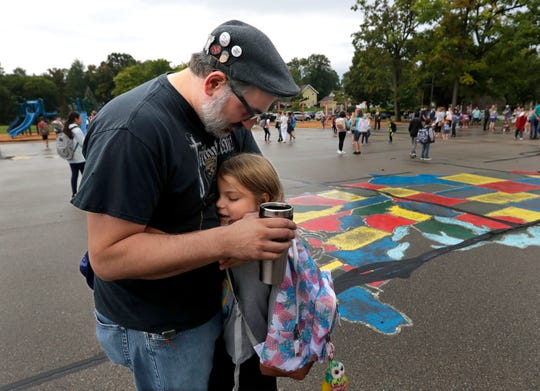 Samantha Carey, 6, hugs her father Derrick Carey as they say goodbye on the first day of school Tuesday, September 3, 2019, at Jefferson Elementary School in Appleton.