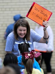 Angie Zengle welcomes her first grade students with a smile on the first day of school Tuesday, September 3, 2019, at Jefferson Elementary School in Appleton.