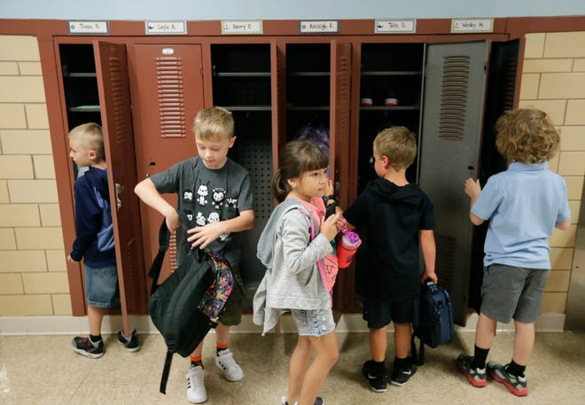 Students head off to their classrooms for the first day of school Sept. 3 at Jefferson Elementary School in Appleton. The Appleton Area School District fared well in the latest round of state report cards.