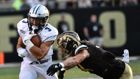 Monmouth receiver Joey Aldarelli picks up yardage after one of his seven receptions in Saturday night's season-opening loss at Western Michigan.