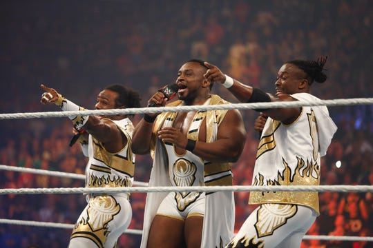 Xavier Woods, from left, Big E and Kofi Kingston of The New Day enter the ring at WWE's SummerSlam at Barclays Center of Brooklyn on Aug. 23, 2015 in New York City.