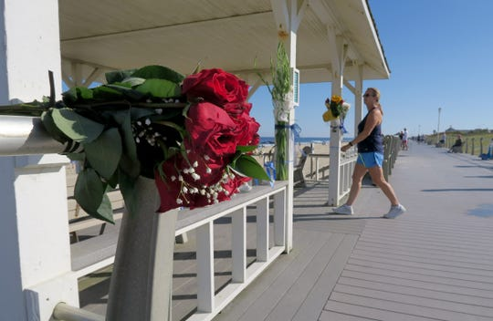Flowers, candles and blue ribbons fill the Newark Avenue gazebo on the Spring Lake boardwalk Tuesday, September 3, 2019.   Josiah Jeremiah Robison, 15, Ewing Township, was caught in a rip current near the jetty Sunday afternoon and was lost to the ocean.