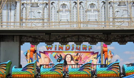 The Windsurf ride can be seen through another midway attraction at this year's setup at the Taylor County Expo Center.