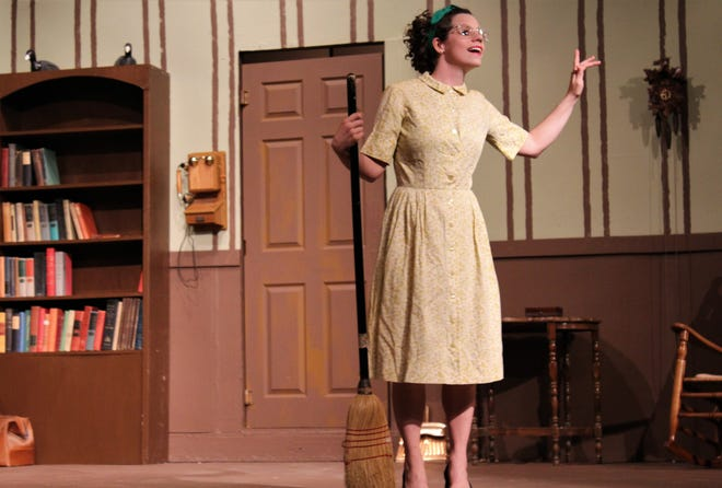 """Amber Barber is Lilly Tobin, a twentysomething neighbor who is keeping house for farmer Sam Stover while his housekeeper is hospitalized and also keeping Stover's interest in this rehearsal scene from """"Apple of His Eye,"""" Abilene Community Theatre's season-opening production that begins Friday."""