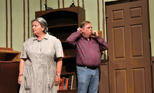 "Foss Springer (Pam Peraza), who wants to buy six hogs at a good price, reacts to what foreman Tude Bowers (Tony Redman) is saying on the phone in this rehearsal scene from ""Apple of His Eye,"" Abilene Community Theatre's season-opening production that begins Friday."