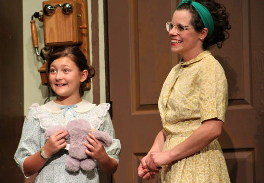 "Carol Ann (Chloe Martin), Sam Stover's granddaughter, lights up at the prospective is seeing kittens with Lily Tobin (Amber Barber) in this rehearsal scene from ""Apple of His Eye,"" Abilene Community Theatre's season-opening production that begins Friday."