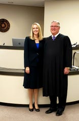 April Propst, sworn in Tuesday morning as associate judge of Taylor County's newly-created child protection court, smiles alongside 326th District Court Judge Paul Rotenberry, who administered her oath.