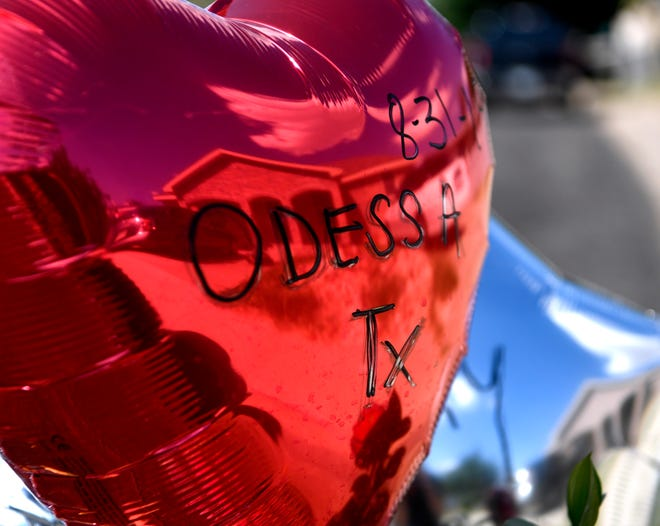 A balloon waves in the breeze on Adams Street in Odessa Monday Sept. 2, 2019, part of a memorial to postal worker Mary Granados who was killed there Saturday along with six others.