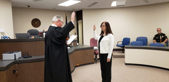 Patty Wenetschlaeger is sworn in by 326th District Judge Paul Rotenberry on Tuesday morning. Wenetschlaeger recently was named associate judge of the 326th District Court, replacing Judge April Propst.