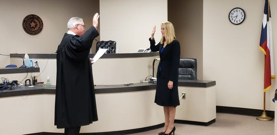 Paul Rotenberry, 326th District Court judge, swears in April Propst, who will serve as associate judge of Taylor County's newly created child protection court. Propst previously served as associate judge of the 326th District Court in Taylor County since 2017.