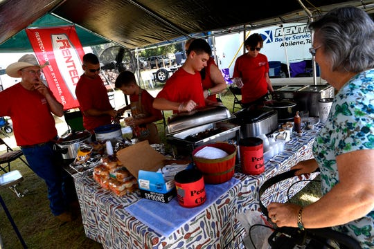 Chili fans line up at the Rentech tent during Saturday in Buffalo Gap.