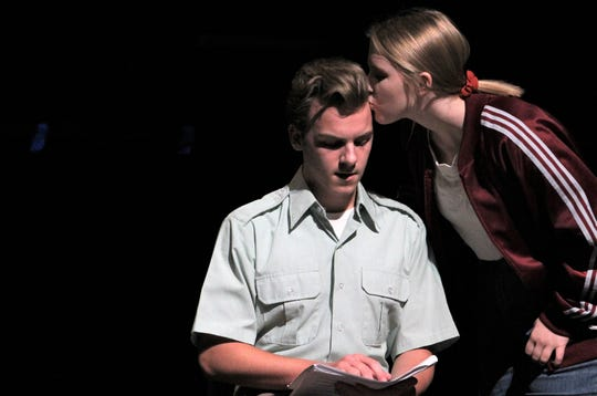 """Jeffrey (Caleb Speights) gets a peck on the head from Miss Wilhelmina (Melia Messer) in this early rehearsal scene from Wylie High School's """"The Curious Savage,"""" which opens Sept. 19."""