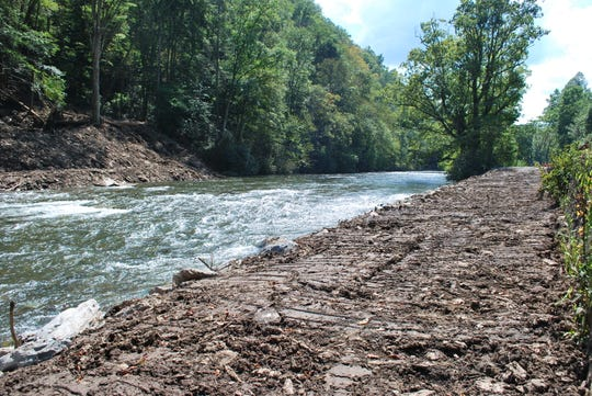 U.S. Forest Service crews and contractors worked sunup to sundown over Labor Day weekend to remove 7,600 tons of gravel and dirt from the Nantahala River. The river has been closed to the public since Aug. 28 for hazardous conditions due to landslides.