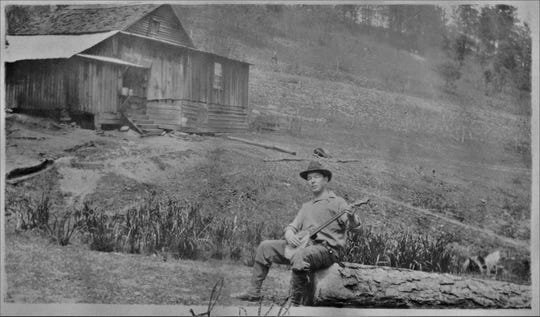 Bascom Lamar Lunsford, a famed ballad collector who would establish the Mountain Dance and Folk Festival in 1928, traveled the mountains in search of songs and performers. Here he is pictured in 1925 in Greasy Cove, an old community in Leicester.
