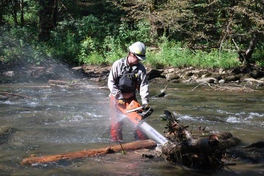 Nathan Dewhurst, Nantahala River Ranger with U.S. Forest Service performs river debris cleanup Sept. 3.