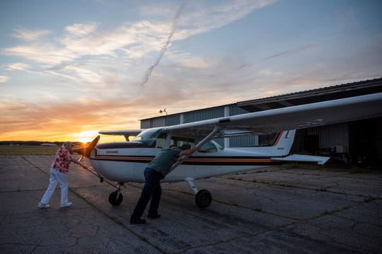 Betty Young and Jerry De Santis push Betty's Cessna 172 Skyhawk into a hanger at W.K. Kellogg Airport on Friday, Aug. 30, 2019 in Battle Creek, Mich. To celebrate her 90th birthday, Betty flew from Battle Creek to Jackson to have dinner with her pilot friends.