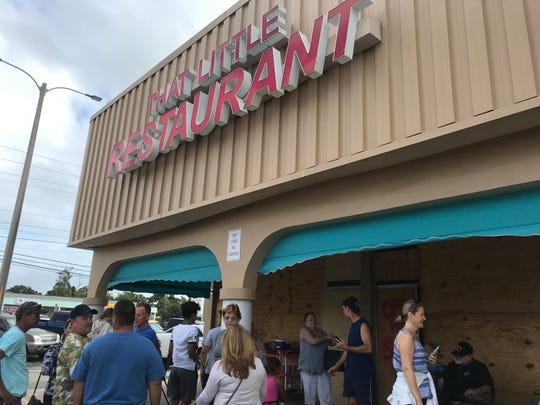 People line up to eat at That Little Restaurant, located on Wickham and Aurora road on Sept. 3, 2019. The restaurant remains open despite Hurricane Dorian approaching.