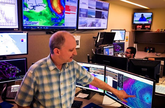 Scott Kelly, senior meteorologist at the National Weather Service station in Melbourne, points at a radar image of Hurricane Dorian on Tuesday morning.