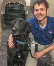 Meteorologist Jerry Combs and his dog, Stuve, have moved into the National Weather Service station in Melbourne.