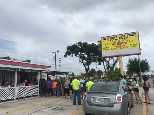 People line up at Mustard's Last Stand on N Harbor City Blvd on Sept. 3, 2019 in preparation for Hurricane Dorian.
