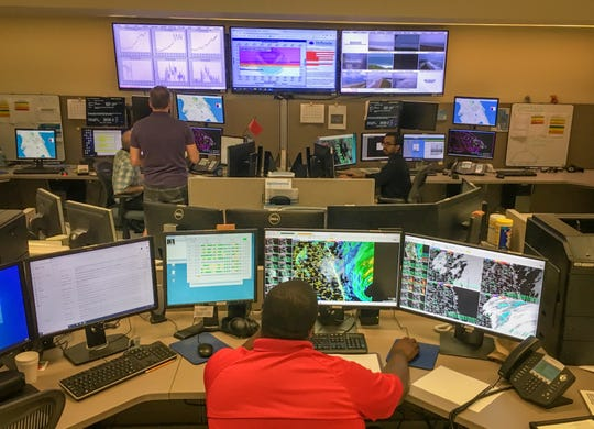 The operations floor Tuesday morning inside the National Weather Service station in Melbourne.