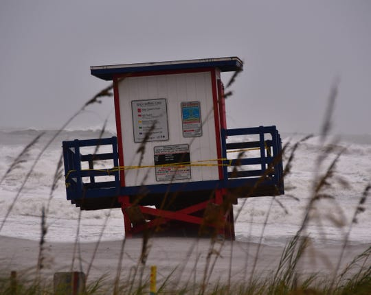 This lifeguard stand at Minutemen Causeway in Cocoa Beach got undermined during high tide as Hurricane Dorian approached.