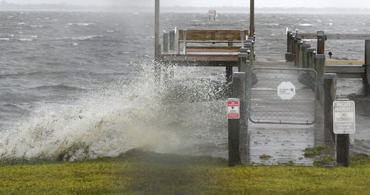 Waves batter a dock along Pineapple Avenue along the Indian River Lagoon in Melbourne, as Hurricane Dorian moves slowly off the coast of Florida's East Coast.