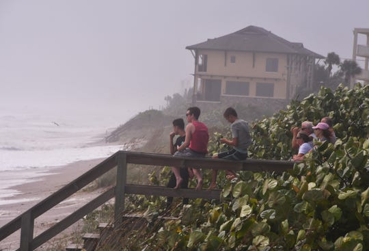 Dorian was a photo op and a spectator event Tuesday in Satellite Beach. The Satellite Beach area at high tide Tuesday was suffered heavy damage from erosion.