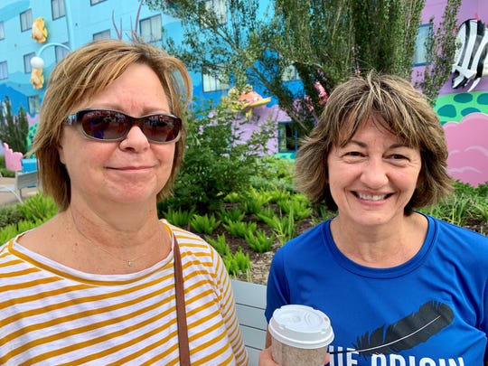 Jan Olson, left, and Katherine Thomas of Merritt Island ran into each other after evacuating to Disney's Art of Animation Resort.