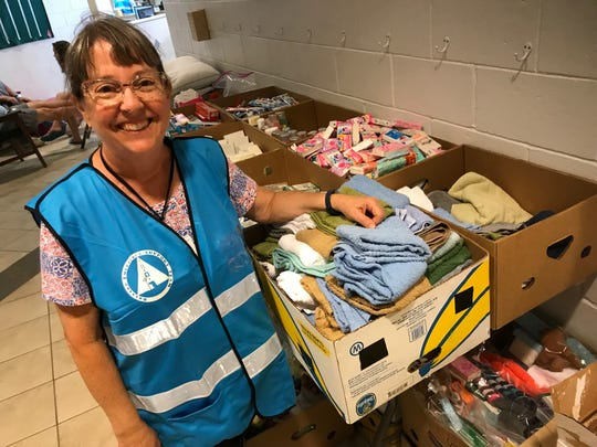 Among those staffing the Walter Butler Community Center emergency shelter during Hurricane Dorian is Nancy Bleakley, a librarian at the Cocoa Beach Public Library. She's pictured with donations of toiletries and other supplies offered by locals.
