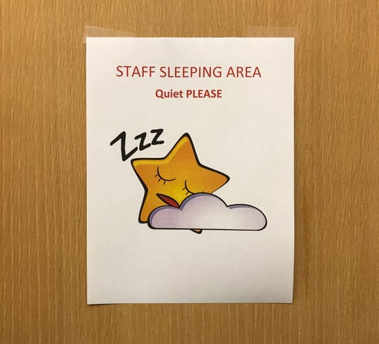 This sign hangs on the conference room door at the National Weather Service station in Melbourne.