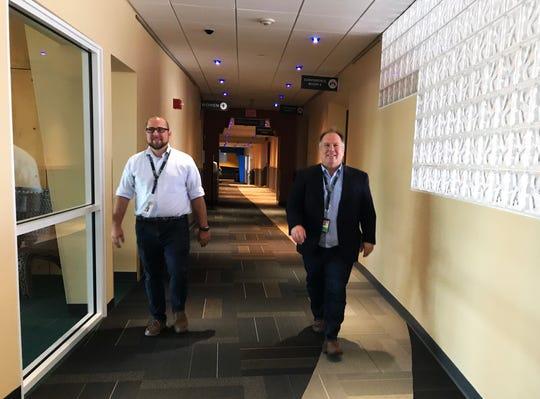 Gene Richards, right, director of aviation at Burlington International Airport, and Nicolas Longo, deputy director, walk through the terminal's second floor on Aug. 30, 2019.