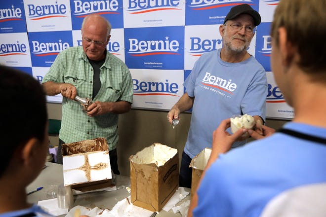 Ben & Jerry's co-founder Ben Cohen, center left, and fellow co-founder Jerry Greenfield, center right, scoop ice cream before a campaign event for Sen. Bernie Sanders, I-Vt., not shown, Sunday, Sept. 1, 2019, in Raymond, N.H.