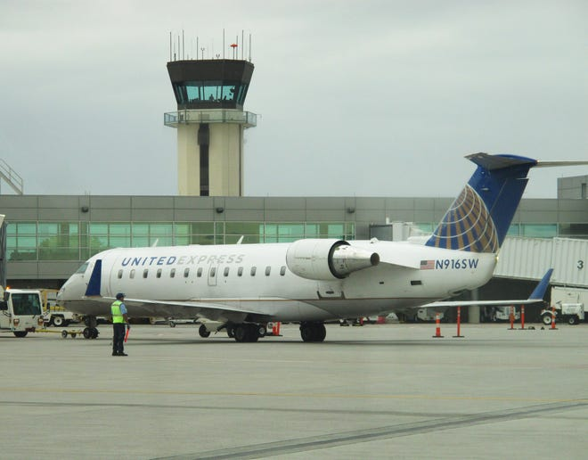 A United Airlines plane prepares to depart from Burlington International Airport on Aug. 30, 2019.