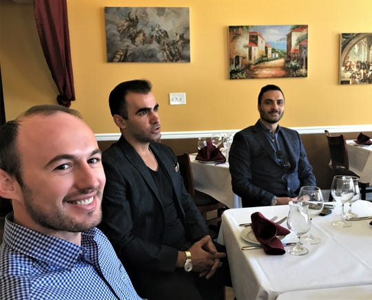 Mare Monte partners (l-r) Emri Cengu, Izzy Reka and Genti Mataj sit in a dining area at their Haddonfield restaurant.