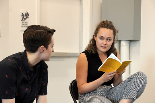 """Jude Walker, left, and Emily Fink are seen in a rehearsal for Ensemble Theatre Cincinnati's production of """"Fun Home."""" Directed by ETC producing artistic director D. Lynn Meyers, the Tony Award-winning musical runs Sept. 4-28."""