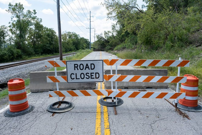 A section of KY 8 is photographed on Tuesday, Sept. 3, 2019.  The 3-mile stretch of road was shut down months ago due to landslides.