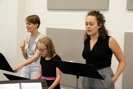 """Based on Alison Bechdel's highly praised graphic memoir, """"Fun Home"""" chronicles the author's coming of age and her confusing relationship with her father. Lisa Kron's script presents the central character at three different ages, performed by (from left) Natalie Bird, McKenna James Farmer and Emily Fink, seen in a recent rehearsal."""