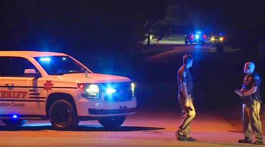 In this photo provided by WHNT-TV News, authorities block access to a street, in Elkmont, Ala., Tuesday, Sept. 3, 2019. Authorities in Elkmont say a teenager called 911 about hearing gunshots and then admitted to killing multiple members of his family. (WHNT-TV News via AP)