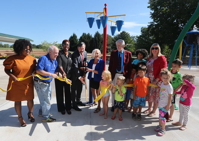 The Somerset County Park Commission opened the new Children's Spray Park at Colonial Park on Colonial Drive near Mettler's Road in the Somerset section of Franklin Township. Childrenjoined officials to cut the ribbon. (Leftto right): Franklin Councilwoman Crystal Pruitt, Franklin Mayor Phil Kramer, Freeholder Shanel Robinson, Freeholder Director Brian Levine, Freeholder Deputy Director Pat Walsh, Park Commission Vice-President Bill Crosby, and Park Commission Assistant Director Cindie Sullivan.
