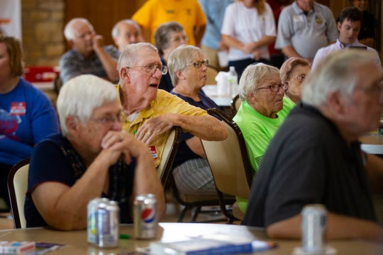 Picnicgoers listen to speakers at the Clinton County Democrats' Labor Day Picnic on Sept. 1, 2019.