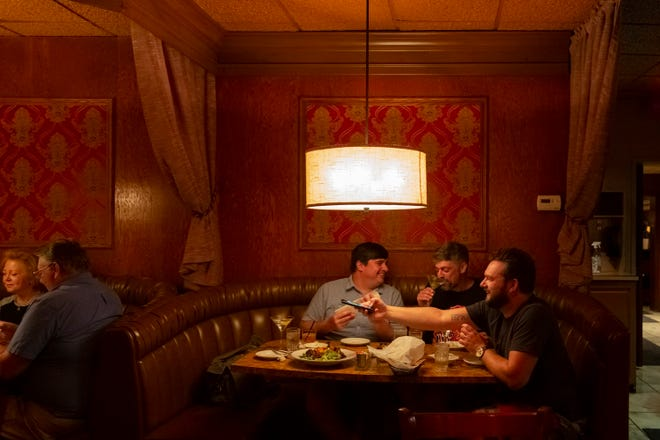 Downriver natives Les Molnar, left, and Scott Warrens share a laugh as Detroit Free Press Restaurant Critic Mark Kurlyandchik snaps a photo at Sibley Gardens in Trenton.