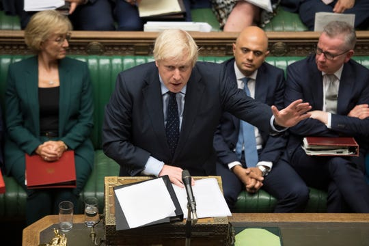 In this image released by the House of Commons, Britain's Prime Minister Boris Johnson speaks in the House of Commons, London, Tuesday Sept. 3, 2019. British Prime Minister Boris Johnson suffered key defections from his party Tuesday, losing a working majority in Parliament and weakening his position as he tried to prevent lawmakers from blocking his Brexit plans.