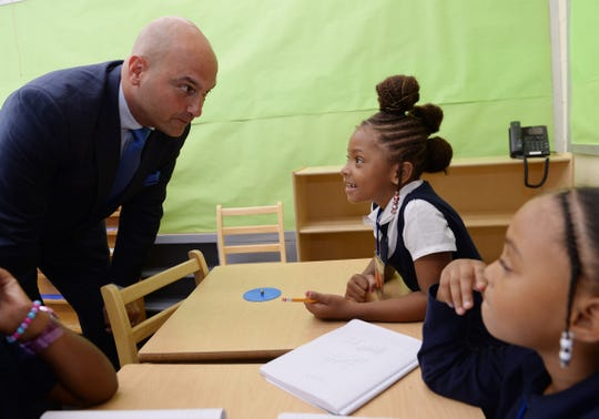 From left, Dr. Nikolai Vitti talks to Zion Doniver, 7, about her goals for this school year. Ma' Laya Barnes, 8. Dr. Nikolai Vitti, Superintendent of Detroit Public Schools visits the students at Edmonson Elementary school on September 3, 2019, Detroit, Mi.