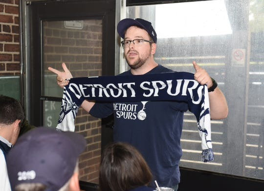 Kyle Youngblood, of the Detroit Tottenham supporters club, speaks to fellow members during a watch party held at the Mercury Bar in Detroit during a match between Arsenal and Tottenham on Sunday, September 1, 2019.