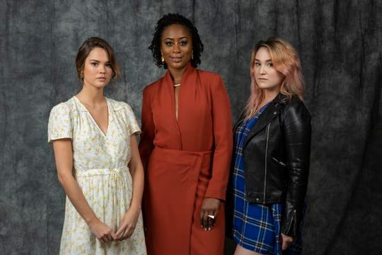 "This July 11, 2019 photo shows Maia Mitchell, from left, Zuri Adele and Emma Hunton posing at a portrait session to promote Freeform's ""Good Trouble"" in Burbank, Calif. (Photo by Willy Sanjuan/Invision/AP)"