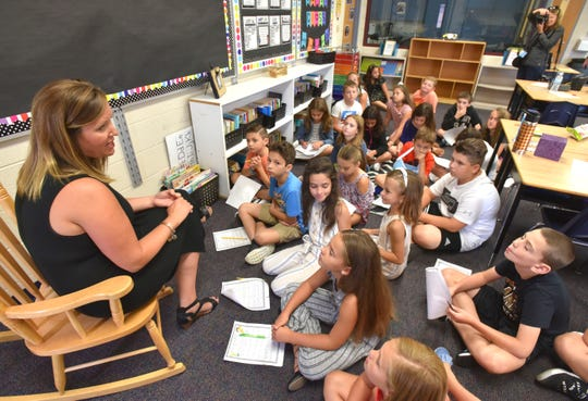 Fourth-grade teacher Jill Lee of Romeo talks with students at Duncan Elementary School in Utica.