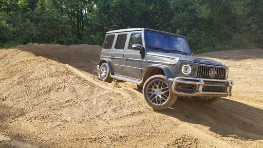 The 2019 Mercedes-AMG G63 might be a hot rod Jeep with its truck frame, boxy exterior, locking differentials and round headlights — just add 577-horse, twin-turbo V8 power.