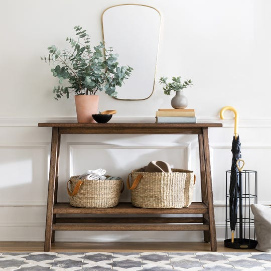 This is a good time of year to refresh your home. Keep seasonal items inside functional finds like storage baskets and umbrella stands.
