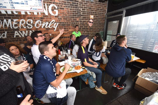 Members of the Detroit Tottenham supporters club gather at the Mercury Bar in Detroit during a match between Arsenal and Tottenham on Sunday, September 1, 2019.